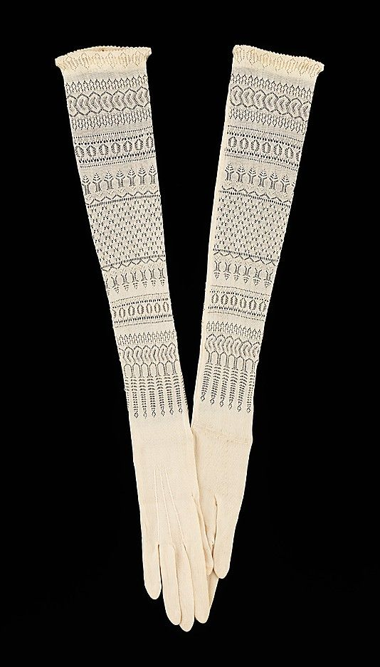 Evening gloves  Date: 1900–1910 Culture: American  The openwork knit pattern adds an extra decorative dimension to the wearer's arms. The combination of the silk knit and the patterned knit is not unlike the way silk stockings covered and decorated the legs.