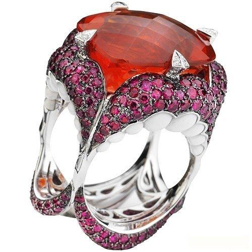 //Gluttony is a ring with an orange Citrine, rubies and white enamel 'teeth'