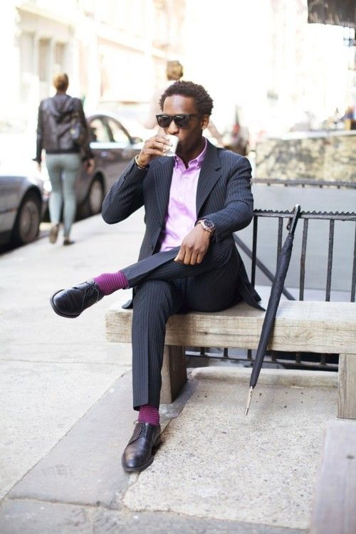 And who says no man should be caught dead in pastel and lavender?     The pastel purple shirt and burgundy socks work wonderfully well with a midnight blue striped suit and dress shoes combination. Complete the look with a black umbrella too!