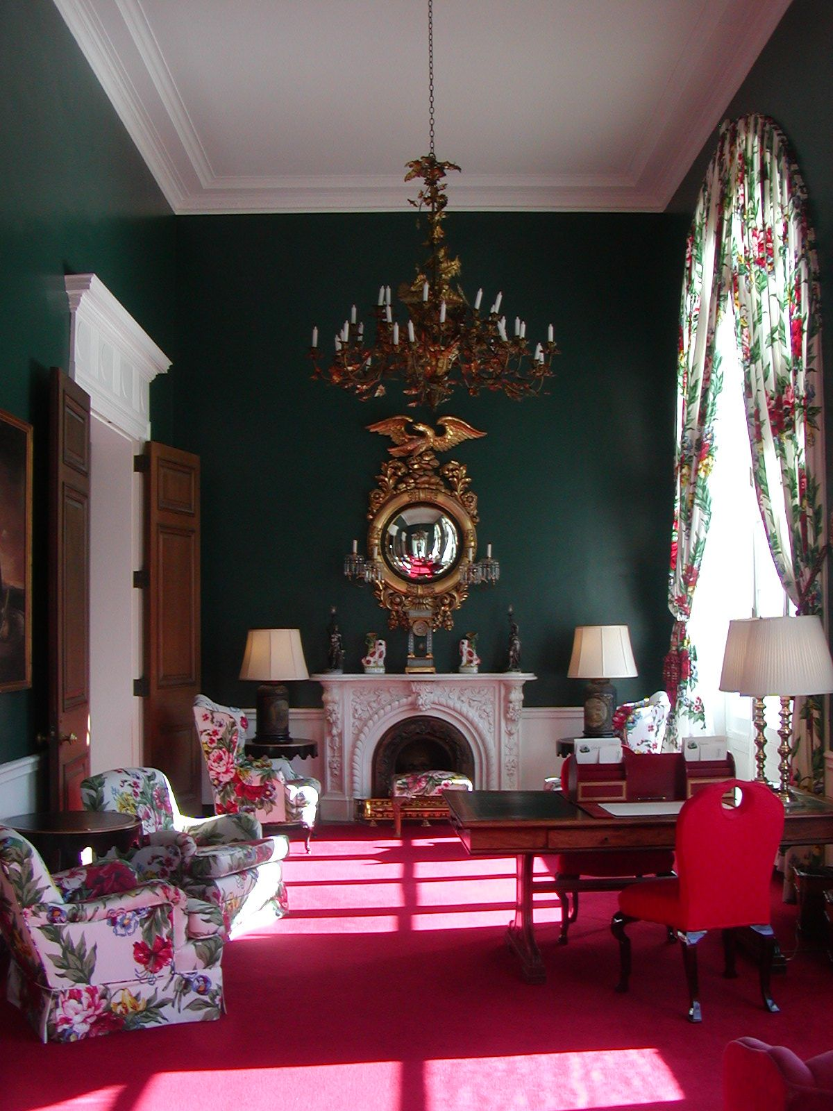 This is one of the most famous rooms of the Greenbrier hotel in West Virginia. Hunter green and a rosy pink red  make quite a statement