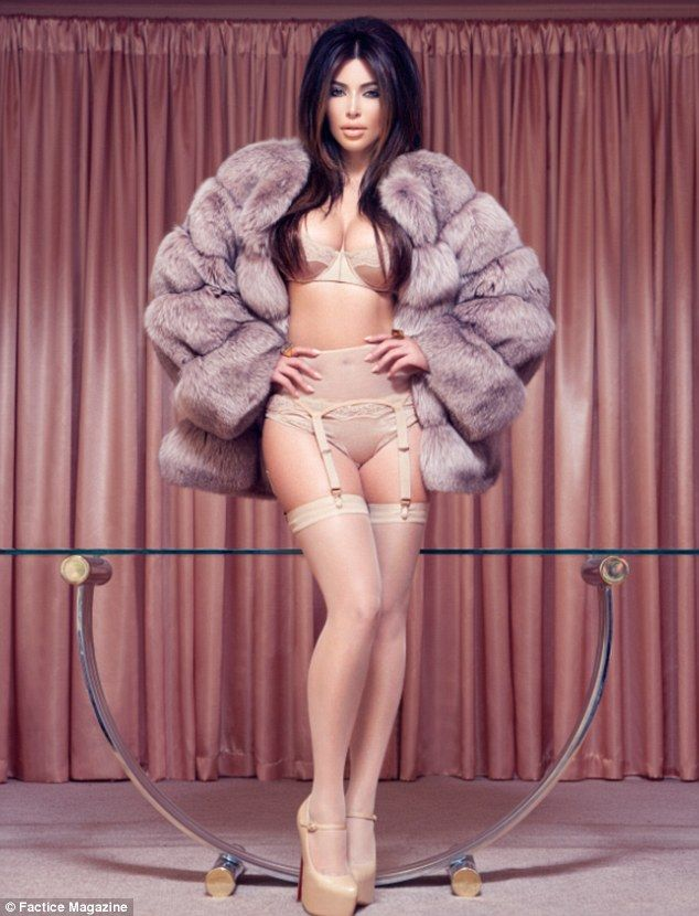 ca2b157551ee ... is certainly every inch the pin-up girl in a beige satin lingerie set,  this time paired with a darker fur coat and sky-high Christian Louboutin  heels
