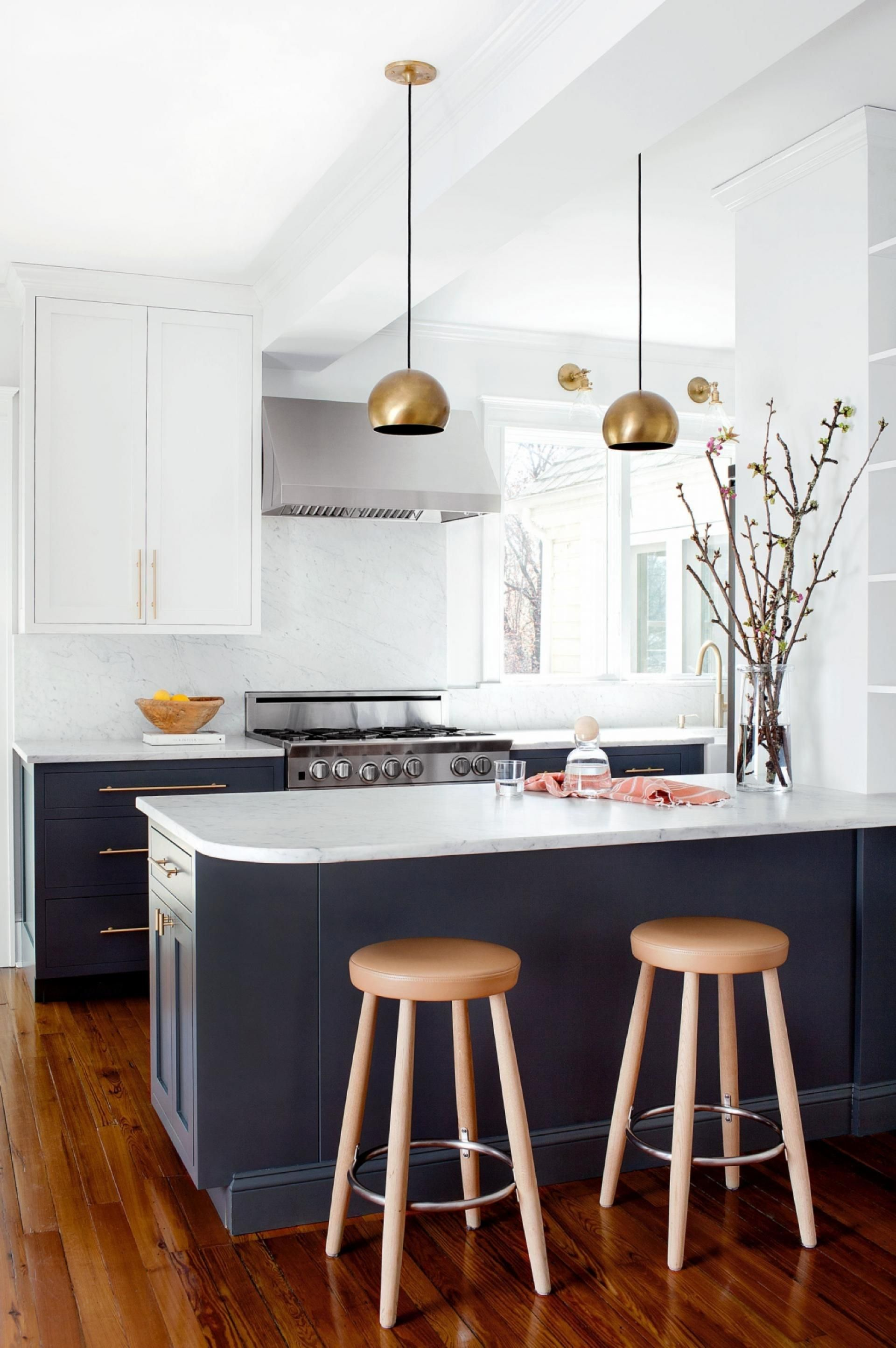 navy-white-timber. The navy cabinets and gold fixtures pair ...