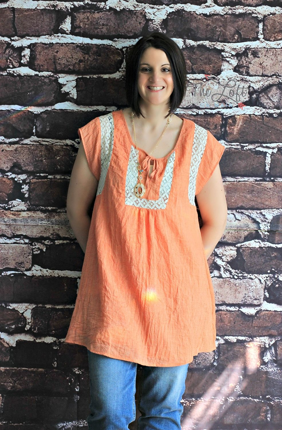 All about apricot with this lovely lace trimmed tunic...  Shop this look at The Loft in store or online...