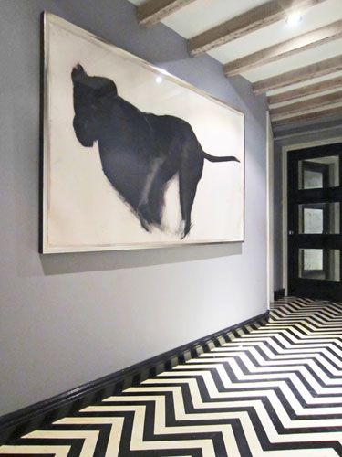 Black and white chevron painted floor.
