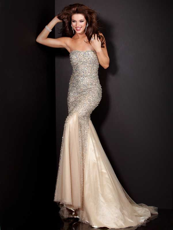 Jovani 4426  Lavishly accented fit-and-flare gown by Jovani Evening    You`re going to fall head over heels for the exquisitely accented design of this strapless Jovani 4426 Evening gown! Its fit-and-flare silhouette is sure to make the most of your lovely figure. Fine, sparkling accents run along the entire bodice and trail off down the breezy, diaphanous skirt. A stunning sweep train completes the look.