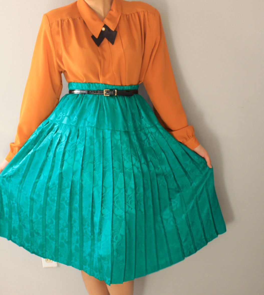 A personal favorite from my Etsy shop https://www.etsy.com/listing/236929425/vintage-green-midi-skirt-green-maxi