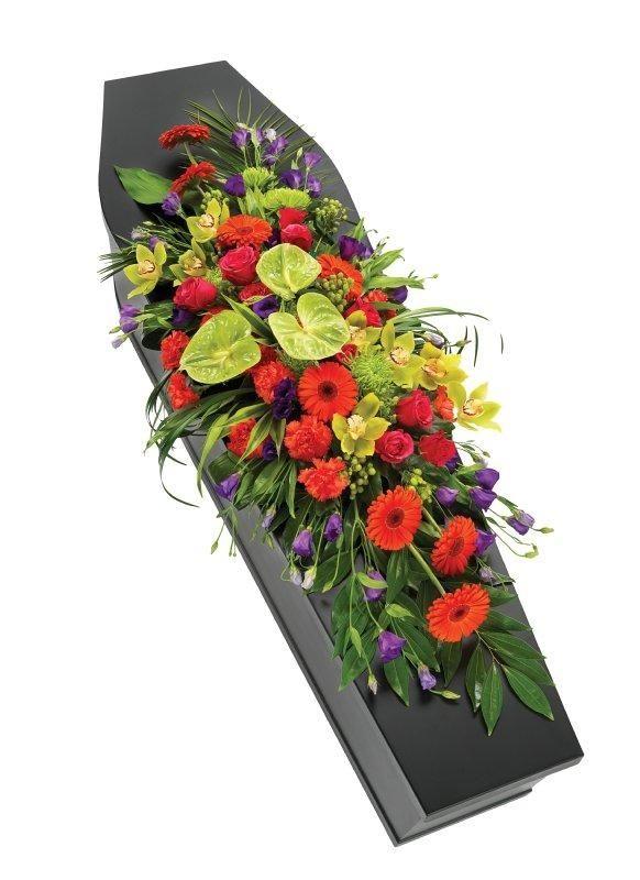 """orange flower casket spray   Vibrant Casket Spray.   Buds the Flower Shop   Harwich, Essex"""""""
