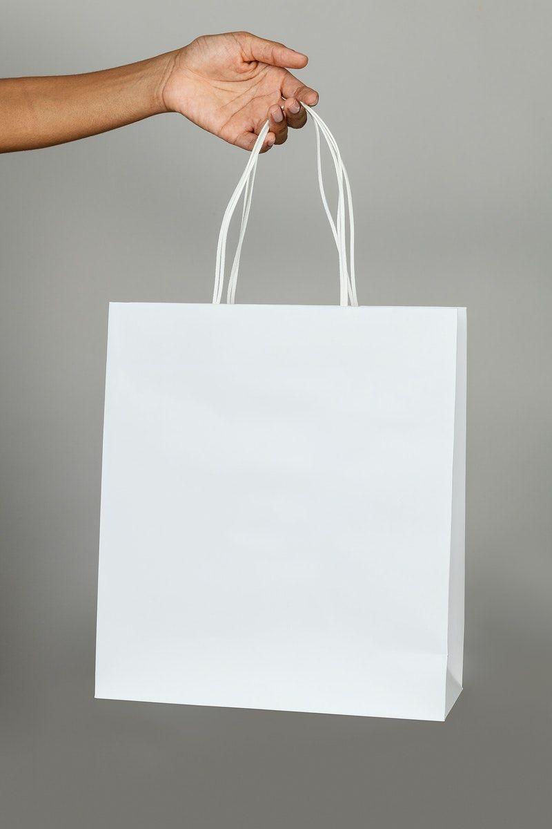 Download Download Premium Image Of Black Woman Holding A White Paper Bag Mockup On Bag Mockup Clothing Mockup Paper Bag