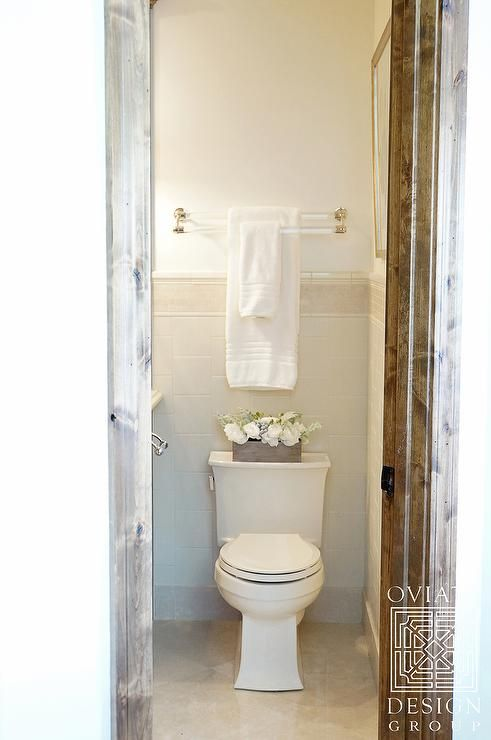 Lovely Bathroom Boasts A Lucite And Brass Double Towel Holder