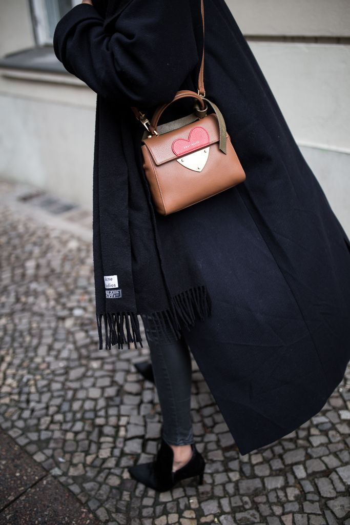 storm wears braun Coccinelle bag with acne studios scarf and zara booties  in black with fur and a black coat minimalist look theadorabletwo 9a35c10758ba2