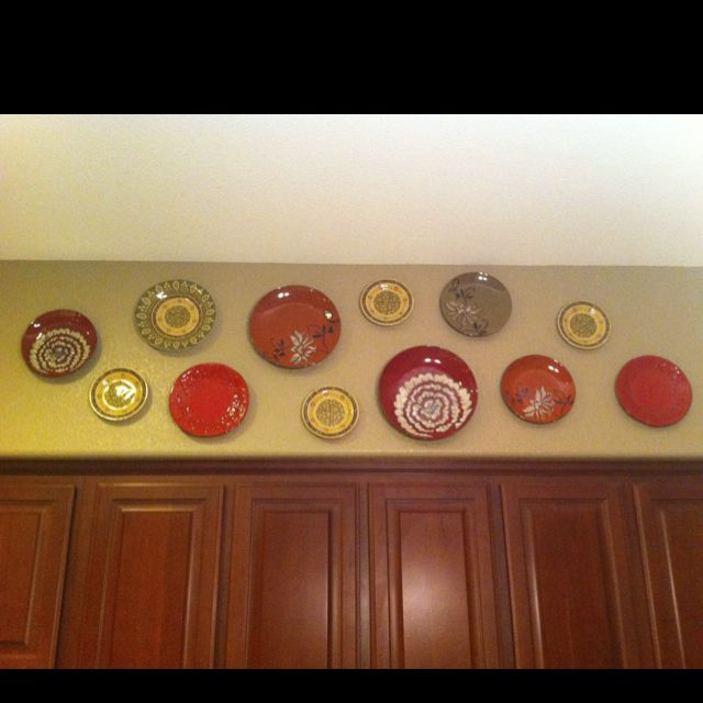 Hanging Plates On Soffett In Kitchen Love This Idea Because We Have A Bunch Of Empty Space Plates From Ross 1 9 Kitchen Soffit Plates On Wall Hanging Plates