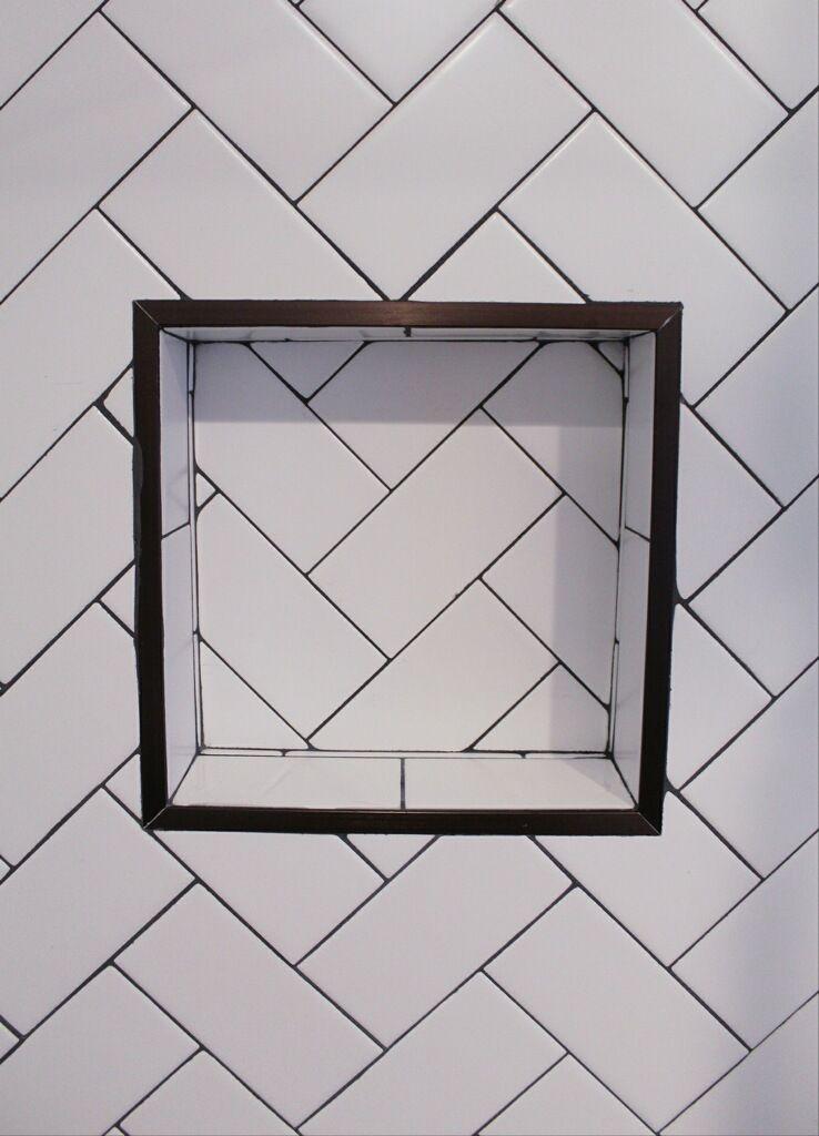 herringbone subway shower niche tile