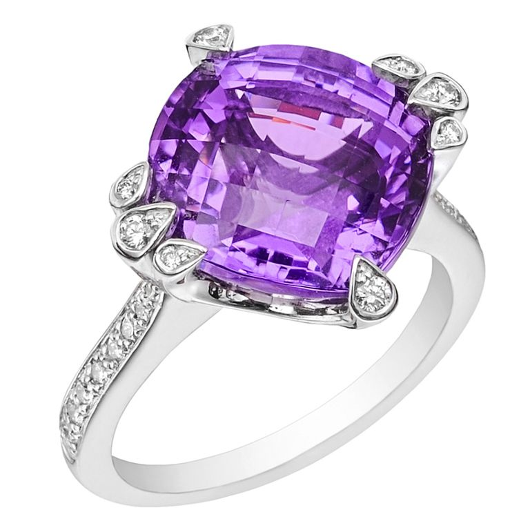 CARTIER Amethyst & Diamond Cocktail Ring. Amethyst and diamond cocktail ring, centering on a cushion-shaped amethyst, with bezel-set diamond prongs and pavé-set diamond shoulders, mounted in 18k white gold, numbered 53CS ON1954, signed Cartier. Size 6.5.