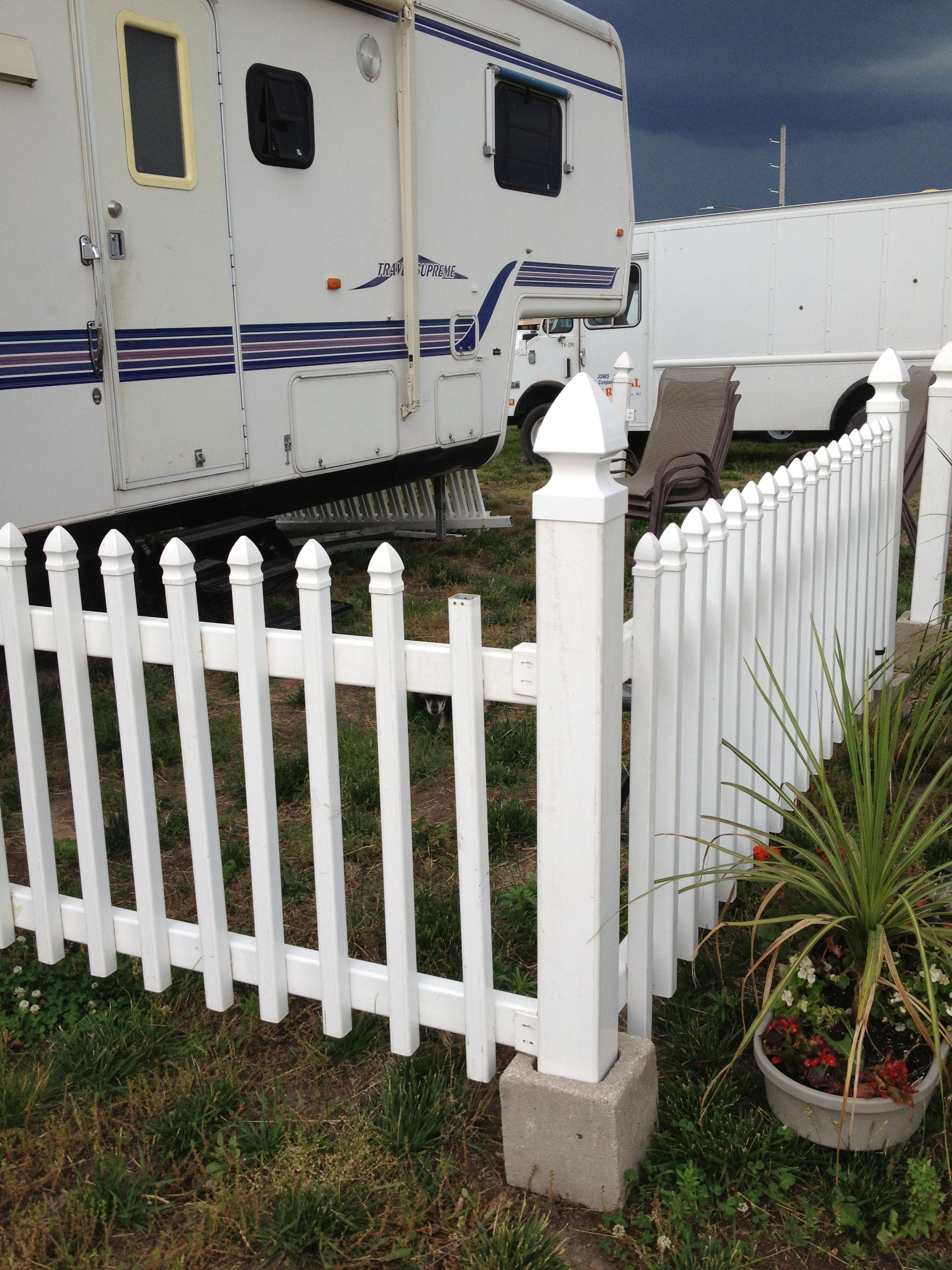 Picket Fence In Cinder Blocks Stable But Moveable