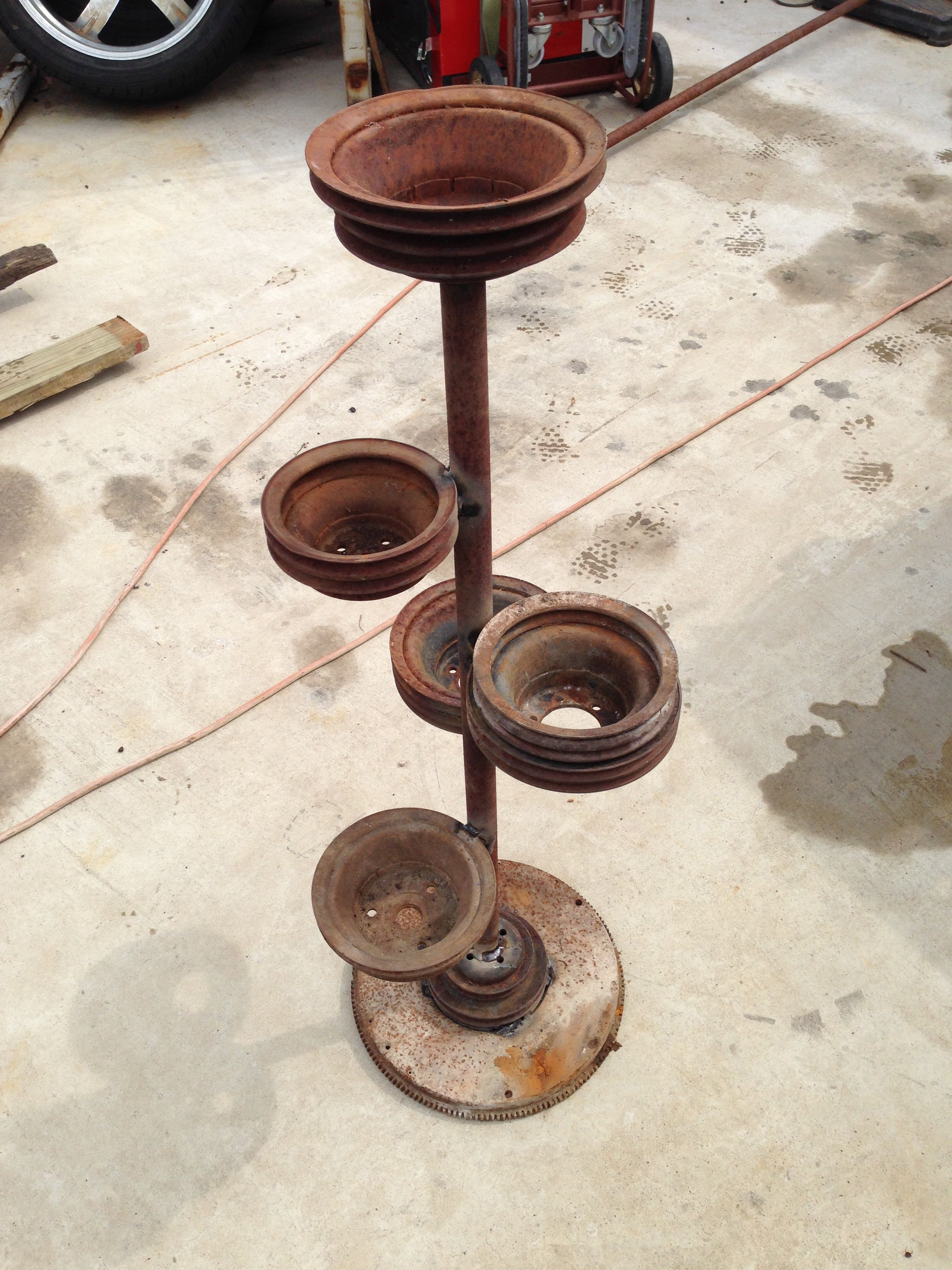 I Made This Plant Stand Out Of Old Car Parts A Flywheel Makes A