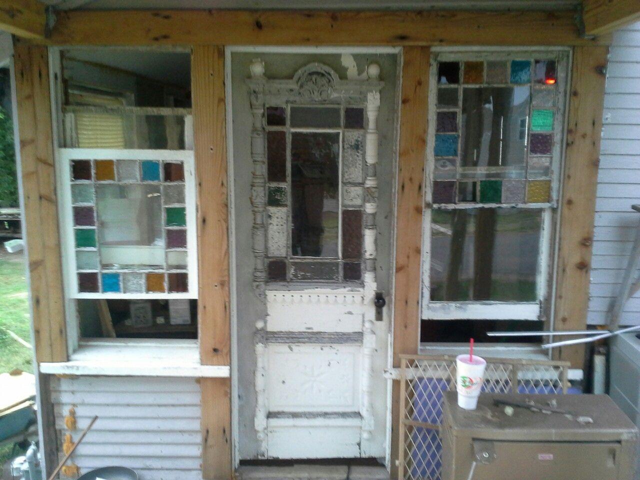 Hand made door original an windows. was originally on the upper front porch. I moved them to the first floor backside corner. Door is handmade.
