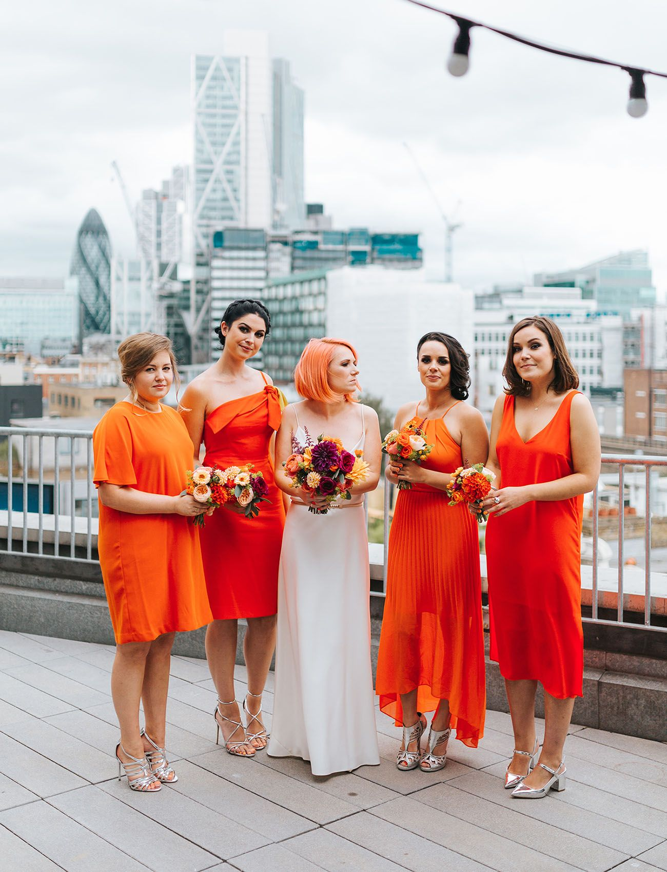 The bridesmaids wore bright orange at this london rooftop wedding eclectic bright vibrant and edgy rock n roll hipster bridesmaids in orange ombrellifo Images