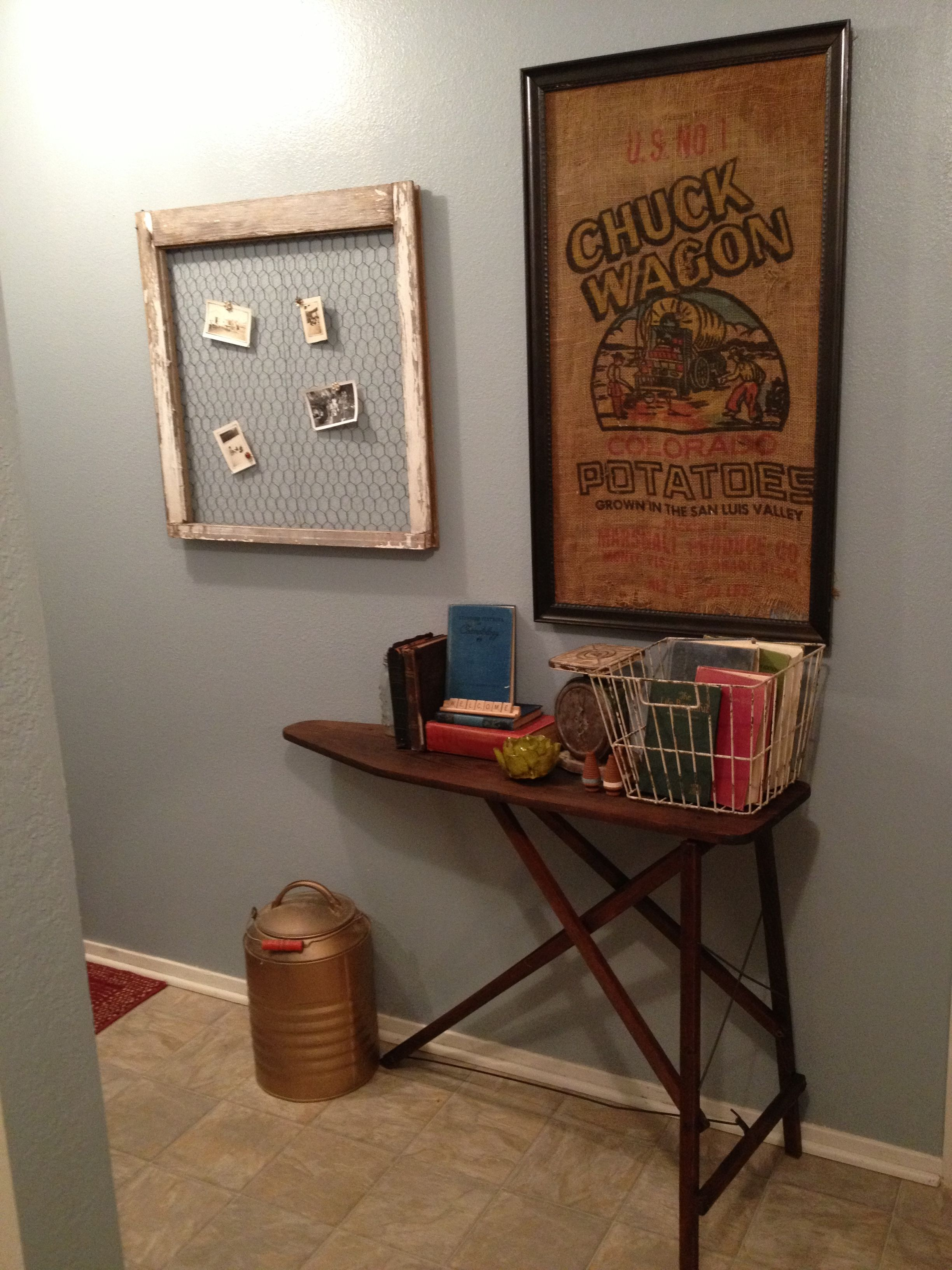 Old wooden ironing board in hallway as an entry table perfect for