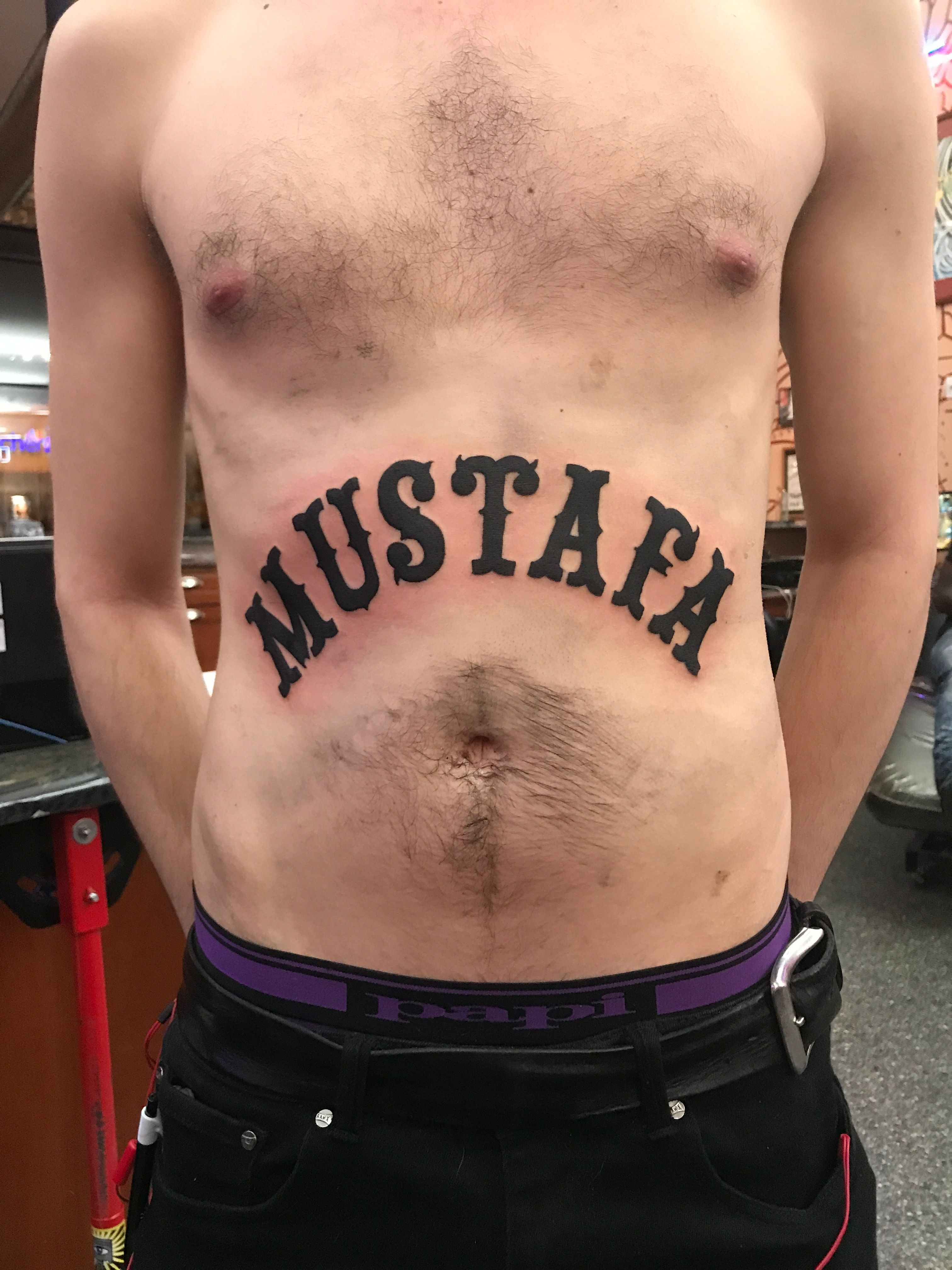 Mustafa Was The Name They Gave Him Black Lettering Stomach Rocker