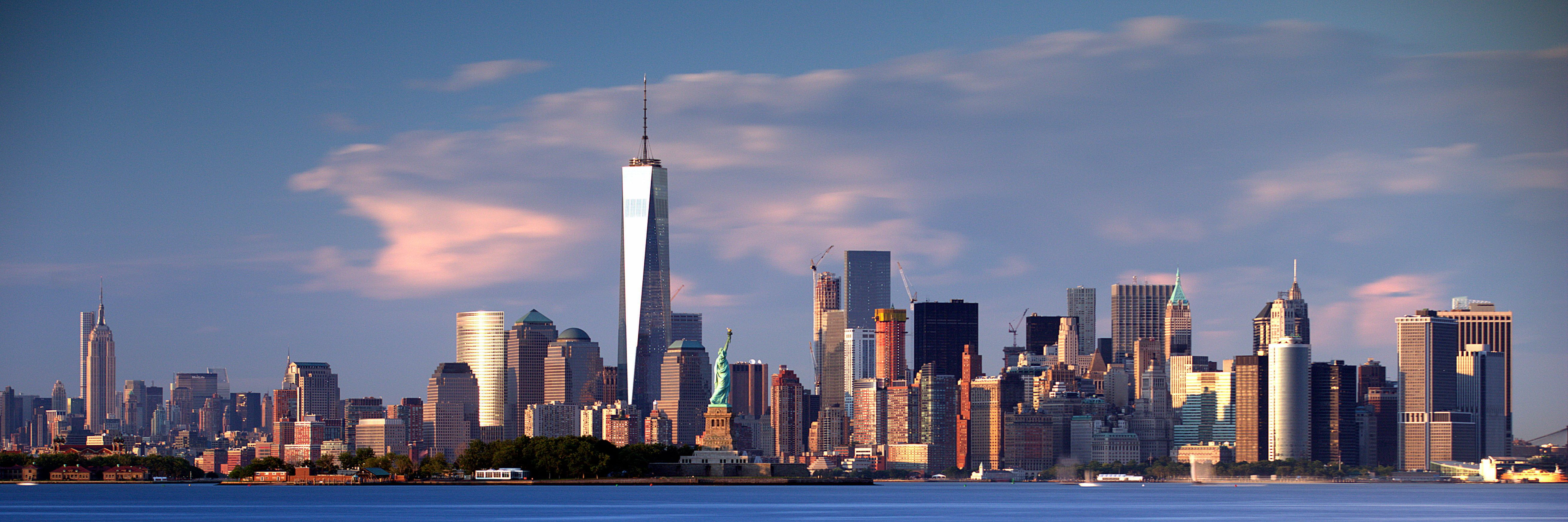 New York City Skyline Under Blue Sky Nyc Downtown Statue Of Liberty Golden Hour New York City Blue Sky Icon Skyline City Skyline Statue Of Liberty Wallpaper