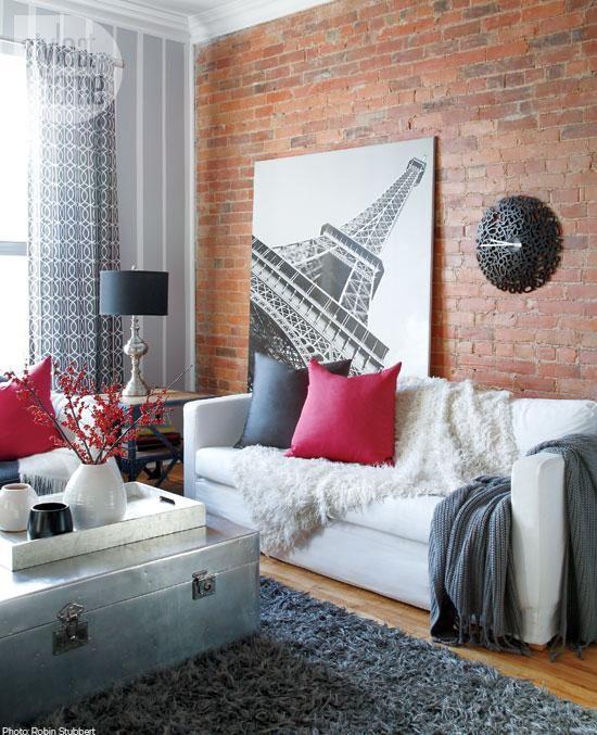 Rustic red brick, textured textiles + plenty of toss cushions. Hello cozy! http://bit.ly/1gMwE3n  #design #decor