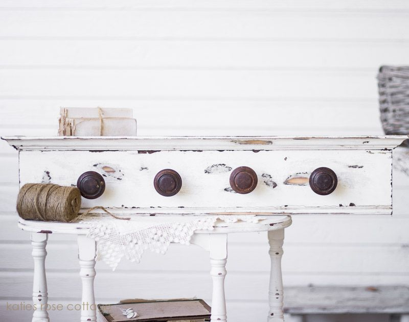 Door knobs and white. Want to do this to my coat rack.