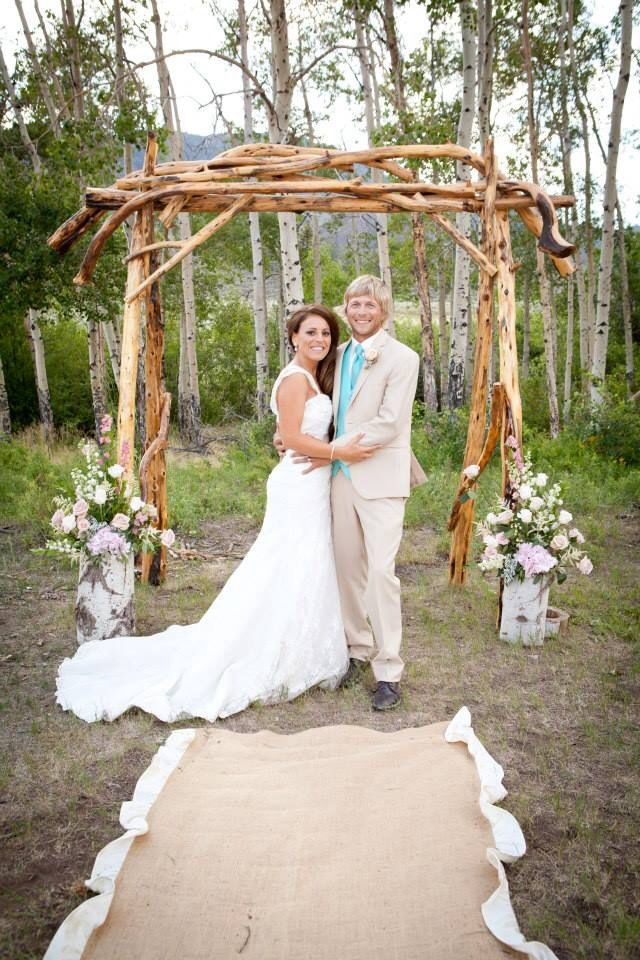 Rusticlooking wedding arch would be really cute with candles