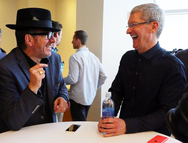 With iTunes Radio, Apple Takes Aim at Pandora.  Apple CEO Tim Cook with musician Elvis Castello.