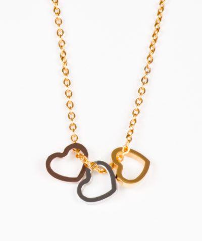 503bac8d96c9 Collar y aretes de corazones en tres tonos de acero inoxidable Gossip  Collection…
