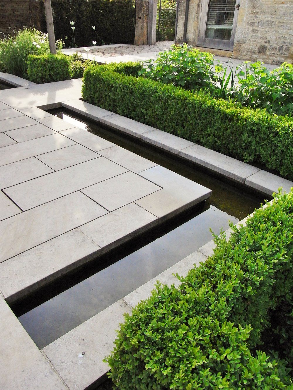 How To Design a Stunning, Practical Patio Part 1 Materials and Styles is part of Contemporary garden, Modern landscaping, Limestone patio, Garden landscape design, Modern garden design, Modern landscape design - If you have any desire to sit outside in your garden, no matter how large or tiny, a thoughtful patio design will make all the difference