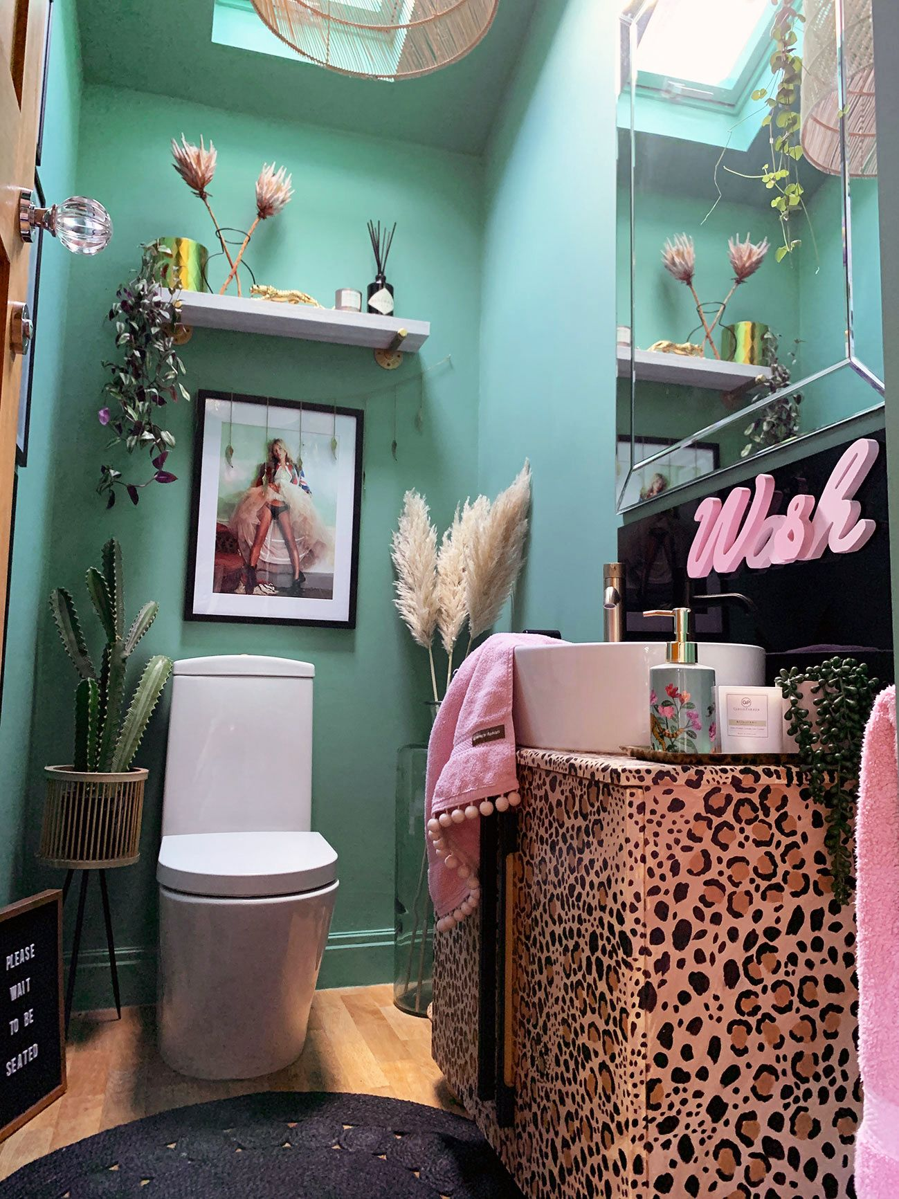 The Glamorous Colourful & Pattern Filled Home of Cara Baker | cloakroom downstairs toilet that uses fun colour, pattern and accessories to make an impact. #cloakroom #powderroom #downstairsloo #decor #homedecor #eclecticdecor #interiordesign #eclecticinteriors #leopardprintdecoor #homedesign #fundecor #interiorinspo #eclectiichome