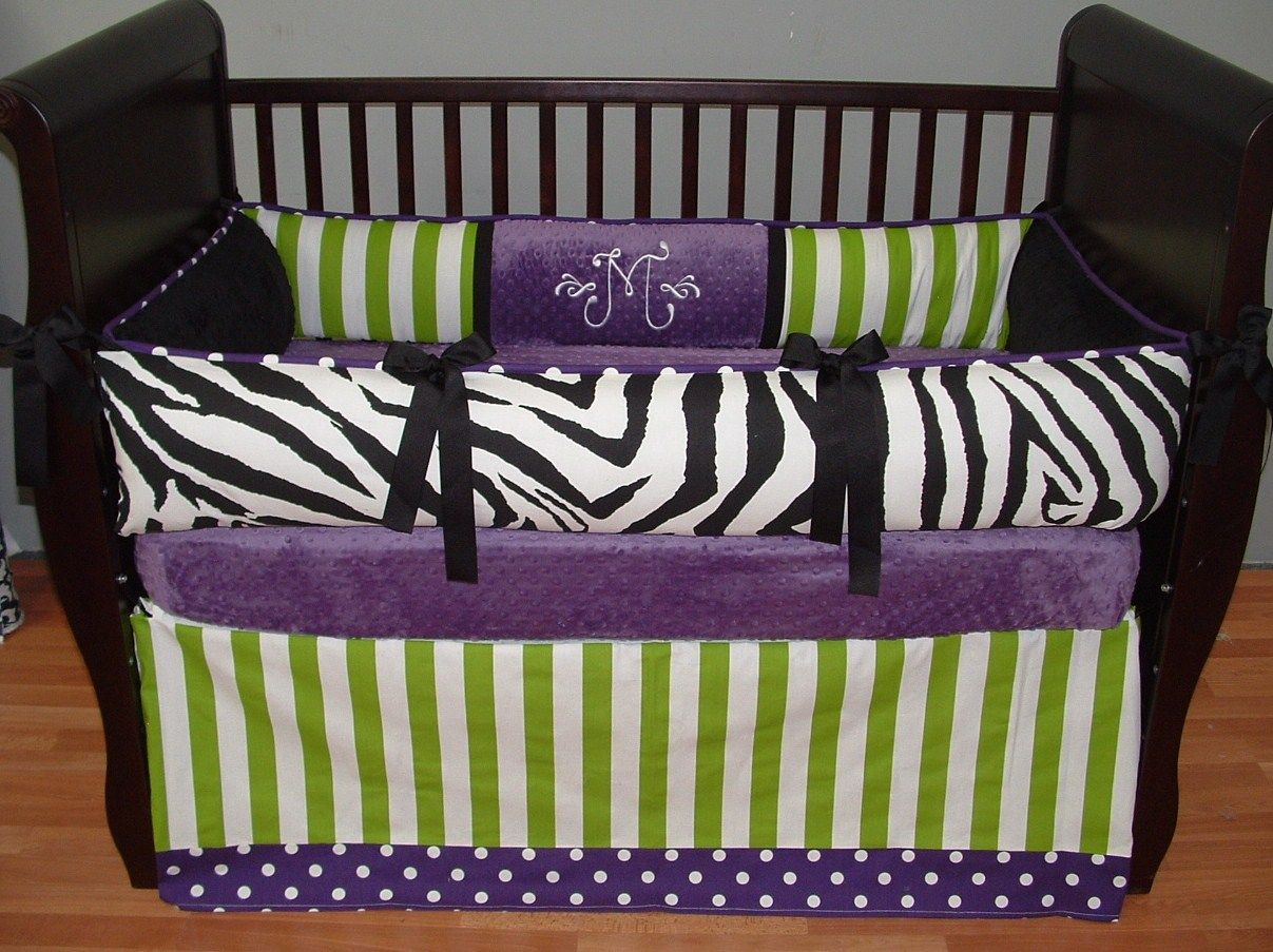 Awesome Black Wooden Crib Decorated With Purple Baby Bedding Plus ...