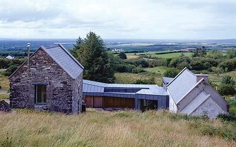 Interiors the house at faha tucked into a hillside in for Cottage extension designs