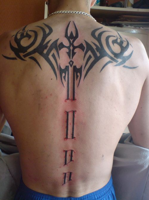spine tattoo sword | sword on back – Tattoo Picture at CheckoutMyInk.com