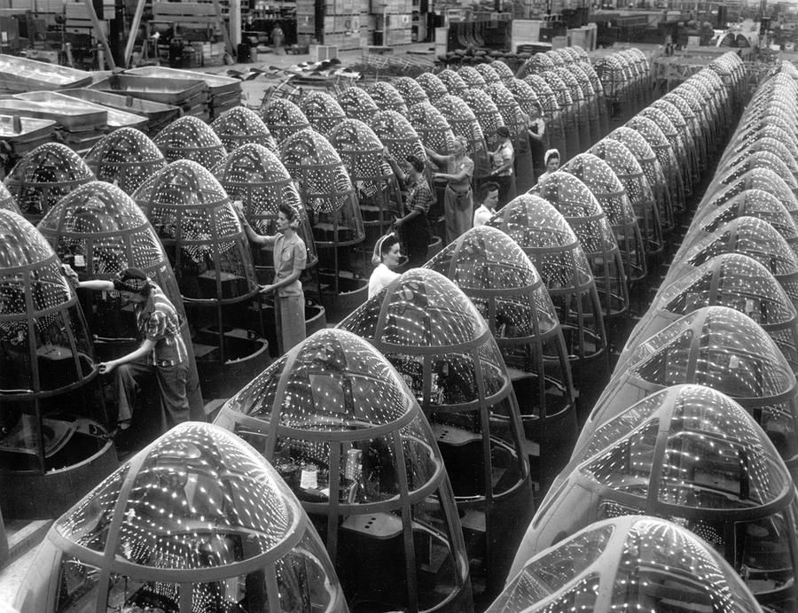 Women workers groom lines of transparent noses for the A-20J attack bombers at Douglas Aircraft's in Long Beach, California, in October of 1942.