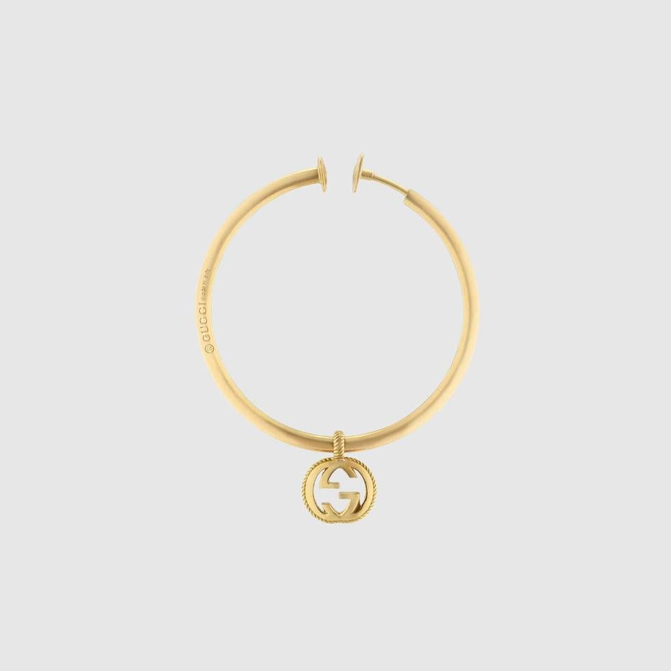 7a7df04464d Shop the Single earring with Interlocking G by Gucci. Repurposed as a  delicate pendant