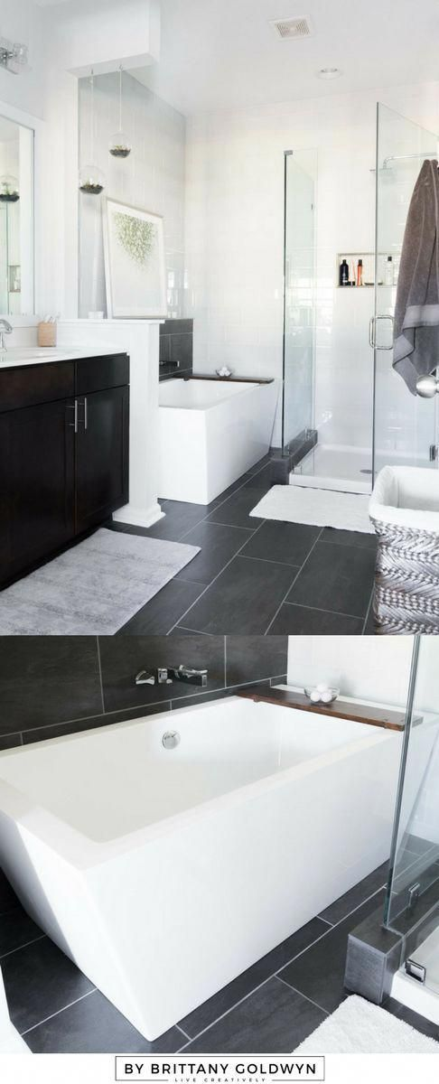 Master Bathroom Reveal Photos // Dark gray large format tile, white glass subway tile, modern freestanding tub, small frameless shower, small bathroom ideas #Bathroomideas