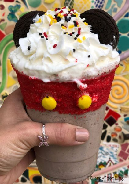 Disneyland Review: Mickey Apple Croissant Donut and Mickey Cookies and Cream Shake at Schmoozies! #disneylandfood