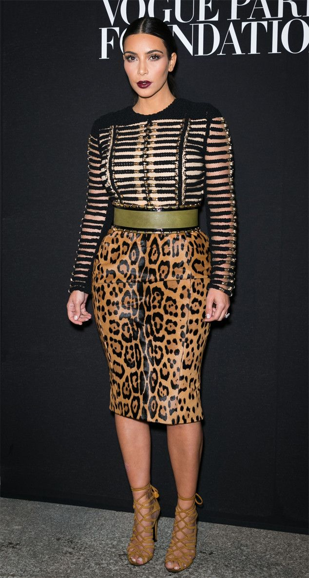 Kim Kardashian from Paris Haute Couture Fashion Week 2014: Star Sightings  Kim delivers her Balmain-best wearing a black and gold ribbed top paired with a sleek leopard-print pencil skirt.