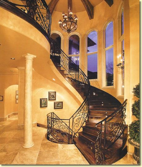 oh wow!  Clearly not in my current house - but I dream of a grand staircase!  Simply stunning!