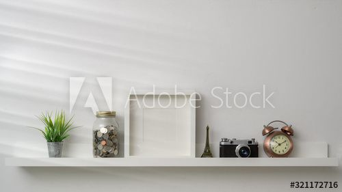 Cropped shot of mock up frame, camera and decorations on white shelf with white wall background , #AFFILIATE, #frame, #camera, #mock, #Cropped, #shot #Ad