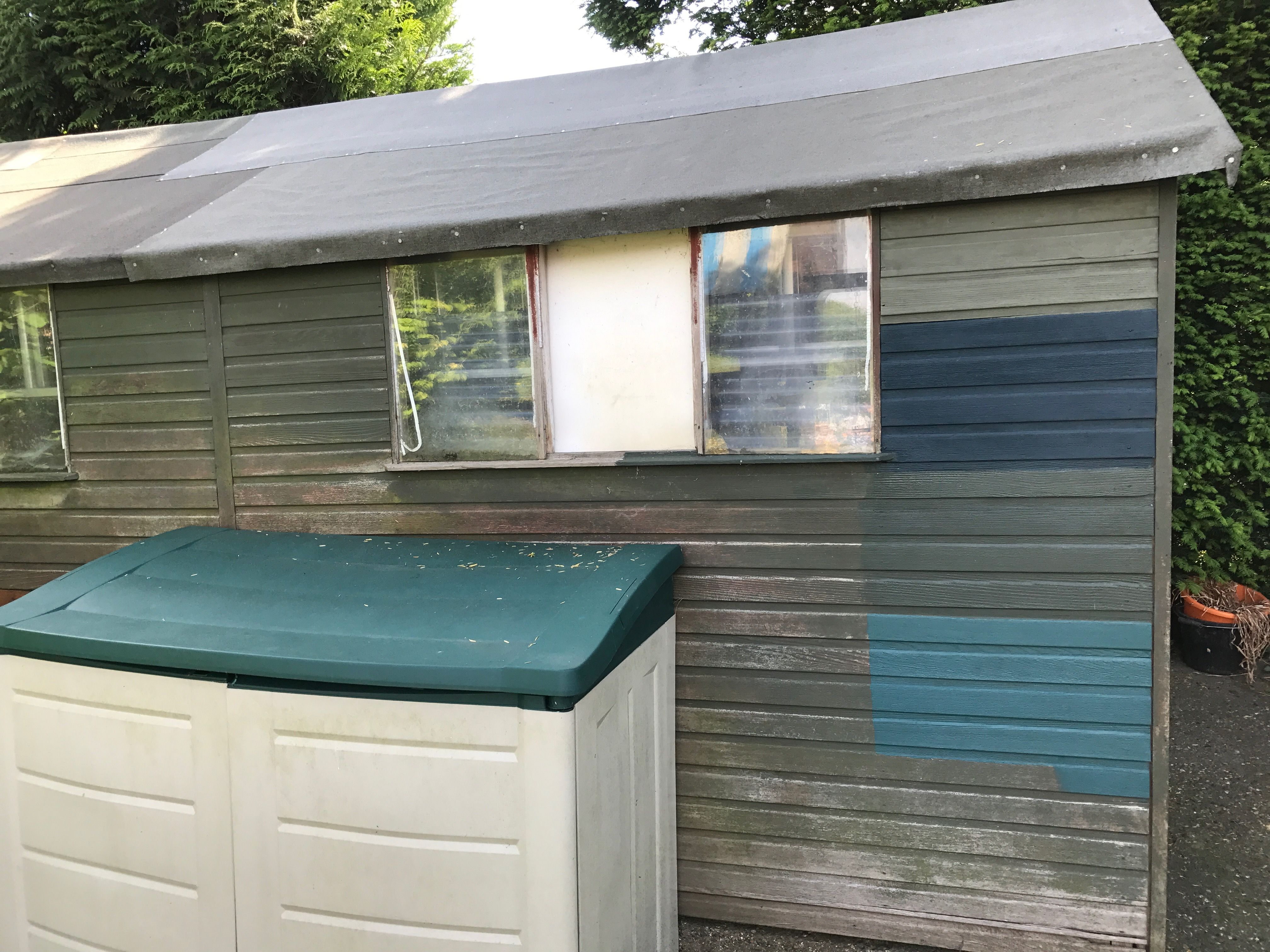 Garden Sheds Painted side of garden shed which needs a makeover - originally painted in