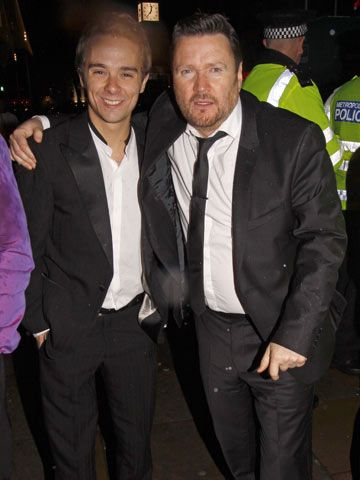 Coronation Street stalwarts Jack P. Shepherd and Ian Puleston-Davies looking exceedingly dazed and uncomfortable backstage after the British Soap Awards at London's Cafe De Paris.  Apparently rumpled, ill-fitting suits are all the rage in Merry Old England.  These men are not in the prime of life obviously and it's rather clear they are definitely in need of a rubdown someplace where maidservants in tight sweaters and kinky eye-makeup take very good care of them for the evening.