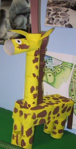Giraffe made out of paint, toilet paper/paper towel cores, construction paper and tissue box.