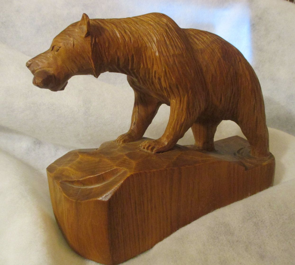 Wooden bear carving by clement dube sculptor wood carver from