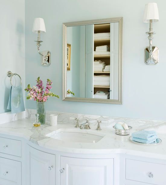 Dream Bath In Blue: A Silver Frame Vanity Mirror    Disguising A Handy