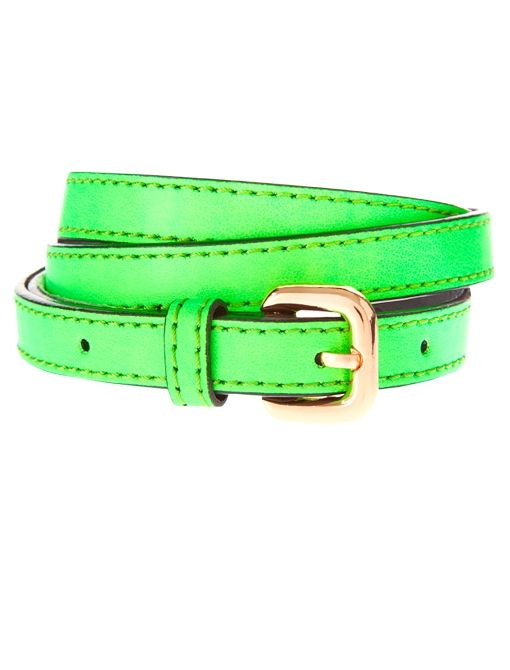 Neon patent skinny belts.