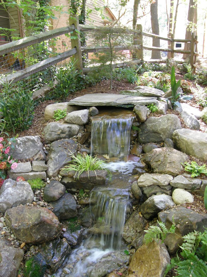 Waterfall Landscape Design Ideas rustic backyard with an amazing waterfall and a cute little wooden bridge Amazing Pondless Waterfalls Garden Design Ideas Outdoor Landscaping Plans With