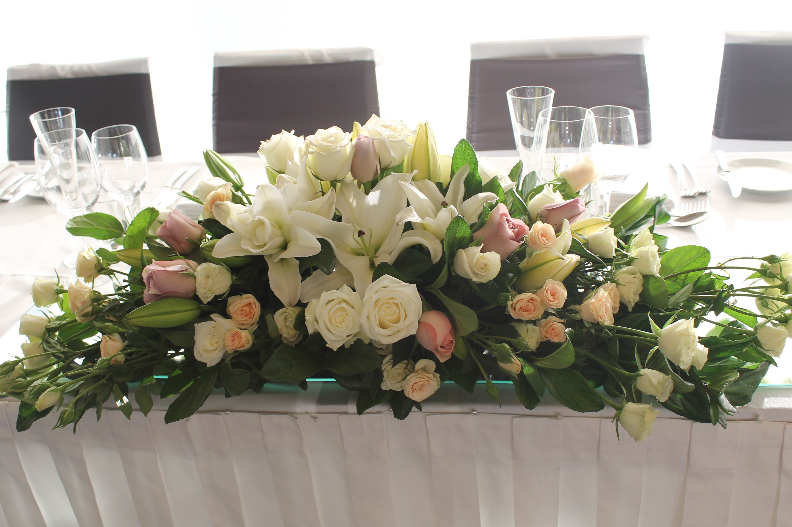 Bridal Table Floral Arrangement Of Fresh Roses And Lisianthus