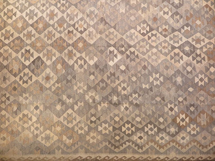 This hand made kilim rug is flat woven in a tapestry weave and made entirely of handspun natural undyed Afghan wool. It is woven by Uzbek weavers…